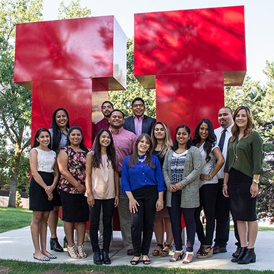 group of students standing in front of the Block U installation on the University of Utah campus