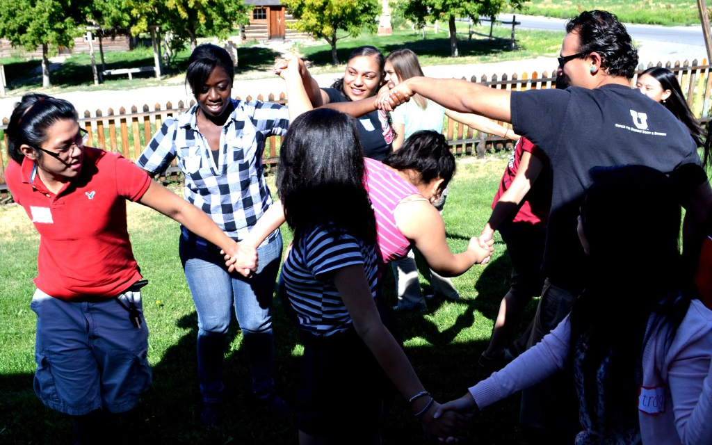 group of students holding hands and doing a group activity