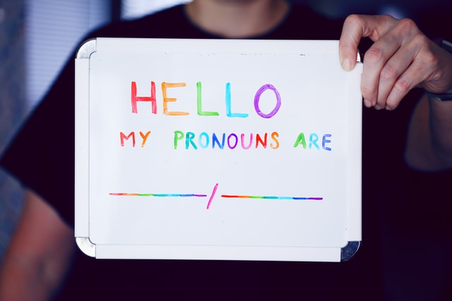 white board with written text: hello, my pronouns are