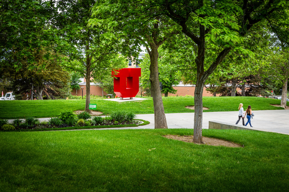 vibrant green landscape and red, Block U installation on the University of Utah campus
